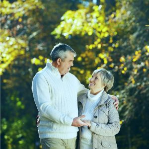 Practices of Healthy Aging - a smiling senior couple in a park