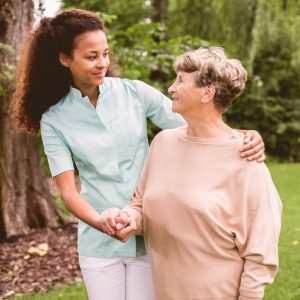 A senior woman and a female caregiver in each other's company