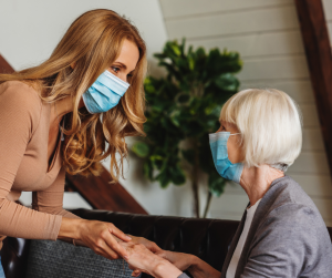 "A caregiver and a senior woman image for the article ""Advantages of home care services for seniors during the COVID-19 pandemic"""